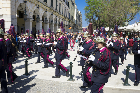 lament: CORFU, GREECE - MARCH 25, 2017: Philharmonic musicians in the customary lament procession on the morning of national day of freedom, at the old town of Corfu.
