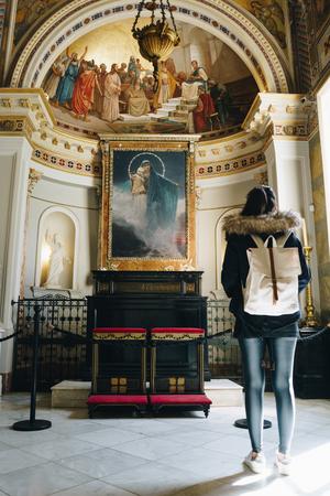 Tourist girl in chapel of  Achillion palace - Corfu, Greece Editorial