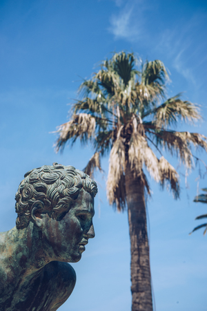 A statue of The Runner in the garden of Achilleion in Corfu palace