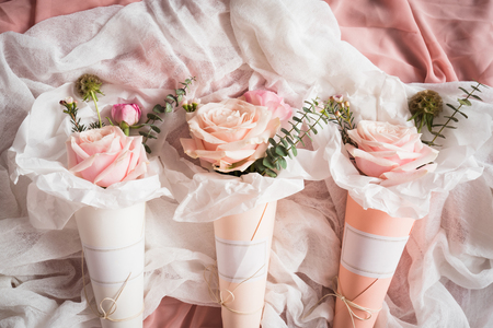 Bouquets of flowers in paper cones