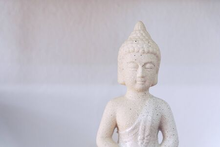 White Buddha isolated in white background