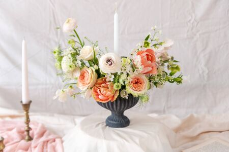 Still life with a beautiful bouquet of flowers and candles