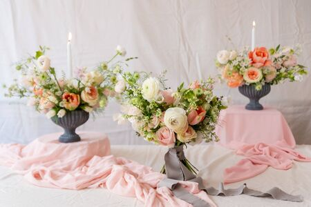 Still life with  beautiful bouquets of flowers and candles