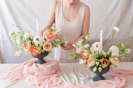 Woman hands touching  a bouquet of flowers. Фото со стока