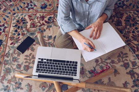 Middle age senior woman hands working on modern laptop at home