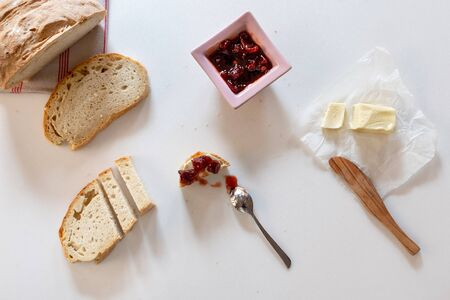 Bread, jam and butter on marble background Stock Photo