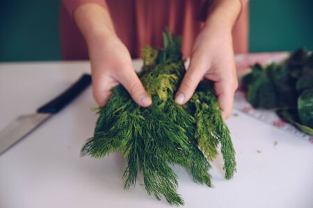 Woman holding  dill leaves
