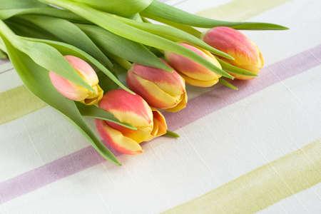 textille: bouquet of tulips on textille serviette
