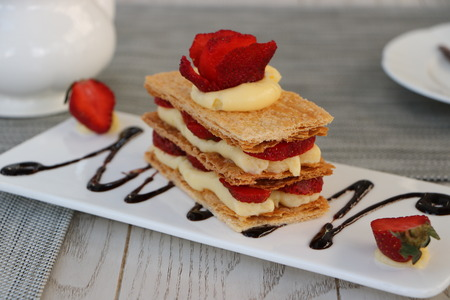 Strawberries mille feuille cake in white plate