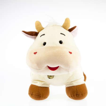 stuffed: a stuffed cow plush on white background.