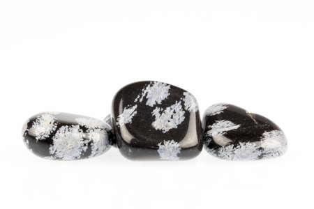 stone volcanic stones: Close up Snowflake quartz on white background. Stock Photo
