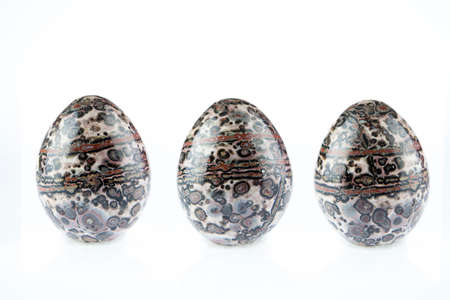 soul searching: multicolored Agate stones egg shape on white background