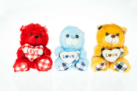 Three Teddy bear and big  heart with text (love) Stock Photo