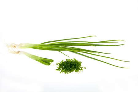 potherbs: Fresh green chives isolated on white background