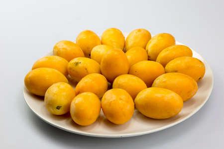rosids: Closeup sweet Marian plum thai fruit isolated on white background Stock Photo