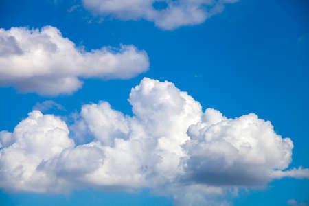 clound: Puffy Cloud Against A Deep Blue Sky in summer