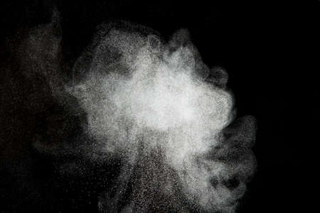 Abstract design of powder cloud against dark background Imagens