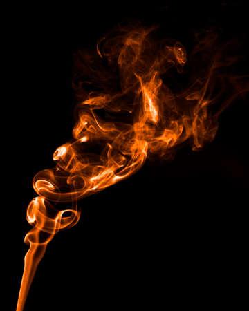 smell of burning: Abstract orange smoke isolate on black background