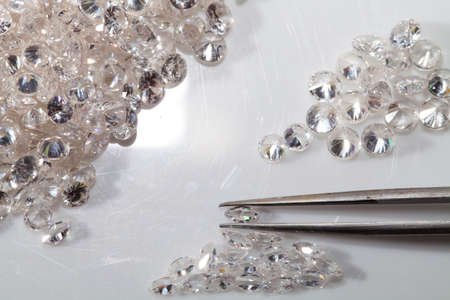 marquise: Selected  round  and Marquise diamond shape with tweezers.