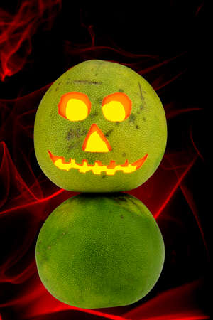 glowing carved: Tropical Jack-o-lantern Pomelo helloween decoration glowing