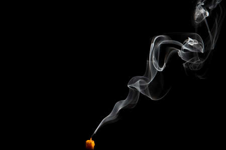black smoke: Smoke isolated with light on black background