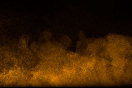the particles: Abstract Flour-like clouds on black background. Stock Photo