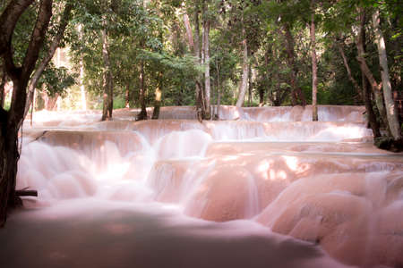 assassinated: Falls features a limestone waterfall Like a large pond The stream flows into the river again. Full assassinated by the shade of large trees, crystal clear water.