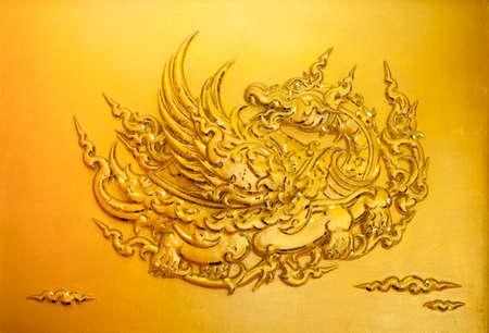 stucco: Gold stucco Thai style on golden background. Stock Photo