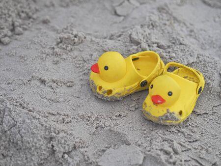 white sand beach: childrens slippers beach duck on white sand