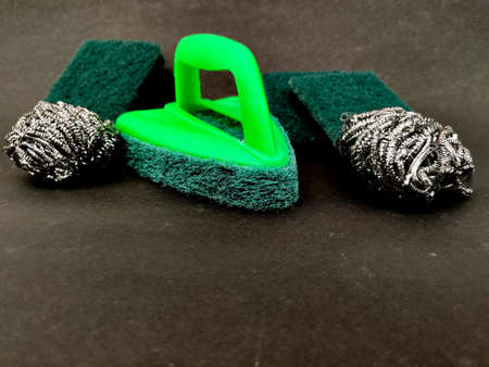 Scrubber pads,stainless steel sponges and bathroom scrubber brush isolated on black background.