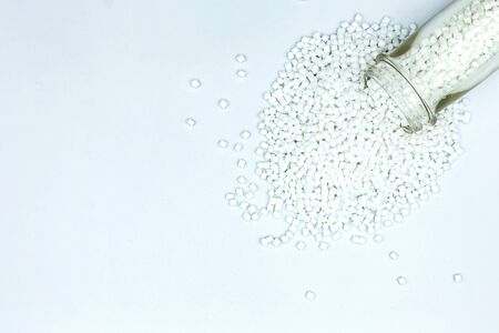 Top view close up White color Plastic beads on white background, Resin plastics for industrial