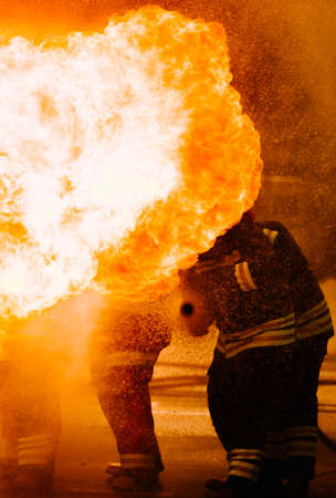 Firefighter training. fireman using water and extinguisher