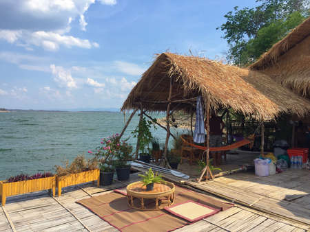 style: A hut by the lake in Thailand