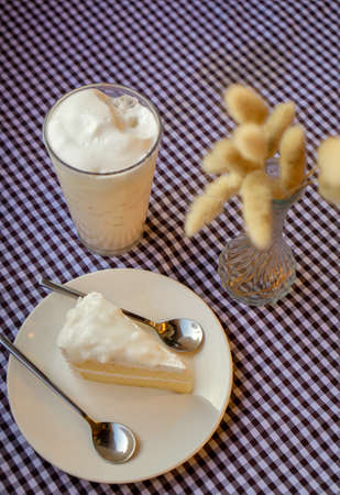 White cake in the plate and drink in the bowl on the dining table Stock fotó
