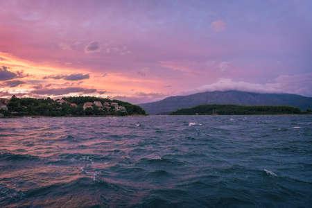 Sailing sunset on adriatic sea Makarska Korcula Croatia. Yacht in marina, sailing in Croatia. Stock Photo