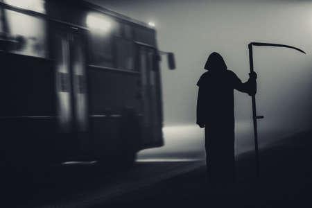 Death grim Reaper skeleton wearing a black robe and wielding a scythe