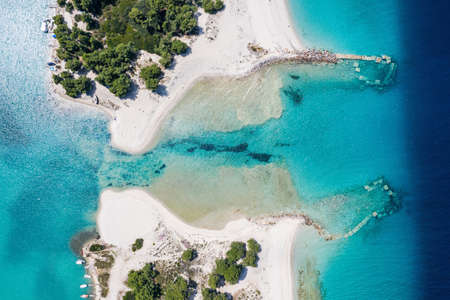 Aerial drone view of Port Glarokavos and lagoon beach in Kassandra penisula Chalkidiki Greece