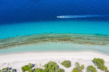 Aerial drone view motorboat in Port Glarokavos and lagoon beach in Kassandra penisula Chalkidiki Greece Stock Photo