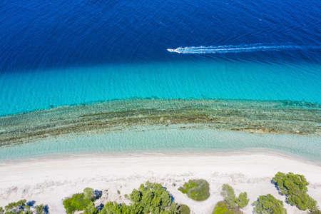 Aerial drone view motorboat in Port Glarokavos and lagoon beach in Kassandra penisula Chalkidiki Greece Stock fotó