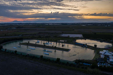 Aerial drone view sunset in Hip-notics cable park wake park in Antalya Turkey. Wakeboarding in Turkey