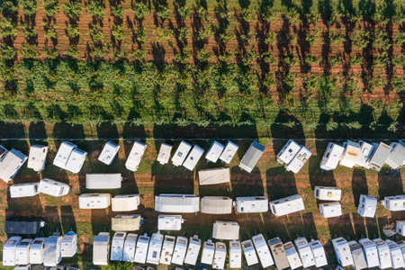Camping site campground full of campers aerial drone photo Archivio Fotografico