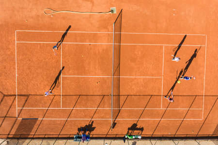Learning to play tennis on court aerial drone photo Archivio Fotografico