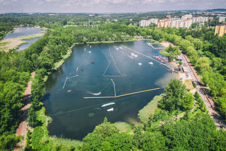 Wake cable park on lake Wakeboarding in the city aerial drone photo