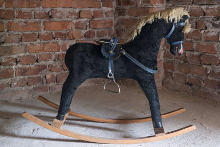 Old retro rocking swing horse Banque d'images