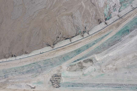 Industrial mine, abstract sendimentation tank of copper mine , turquoise water like river delta. Huge sewage treatment tank in Polkowice Poland