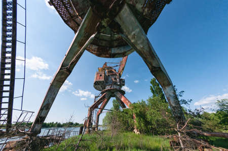 Abandoned dock cranes in Prypiat, Chernobyl exclusion Zone. Chernobyl Nuclear Power Plant Zone of Alienation in Ukraine Soviet Union Stock Photo