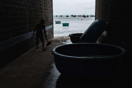 Mui ne fishemans village. Traditional Vietnamese boat in the basket shaped in Fishing village Mui Ne, Vietnam, Asia