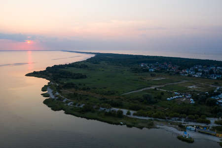 Aerial drone photo view of sunset in Hel penisula Jastarnia Puck Bay Baltic Sea in Poland
