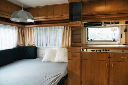 Vacation in camper, caravan. Interrior rooms of Camper caravan car. Holiday on camping in Poland