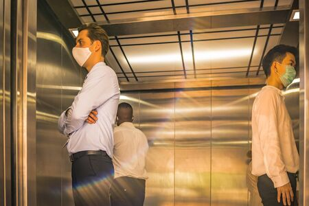 Social distancing concept in elevator with 4 people inside. In case of safety concept from coronavirus or COVID19 outbreak.